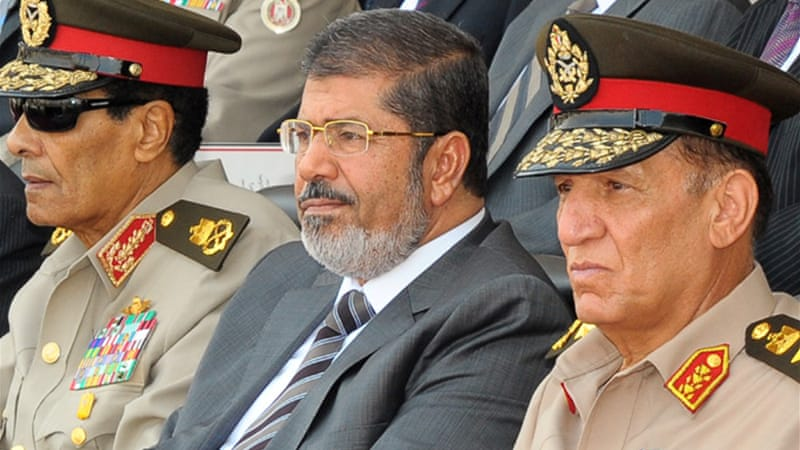 On August 12, Mohamed Morsi ordered defence minister Field Marshal Tantawi into retirement [EPA]