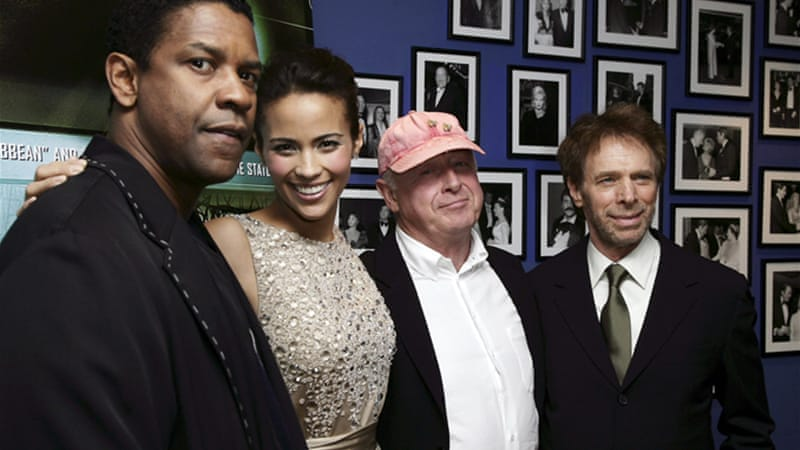 Scott, centre, and Denzel Washington, left, worked together on five films between 1995 and 2010 [Reuters]