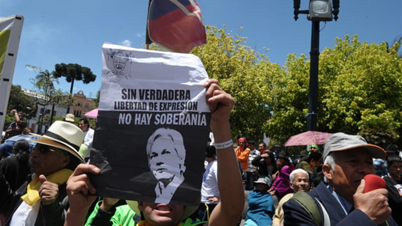 Britain's threat to raid Ecuador's embassy, where Assange is sheltering, has prompted outrage [AFP]