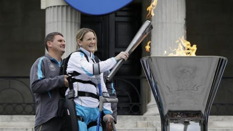 London Marathon runner Claire Lomas lights the Paralympic flame cauldron in Trafalgar Square [AP]