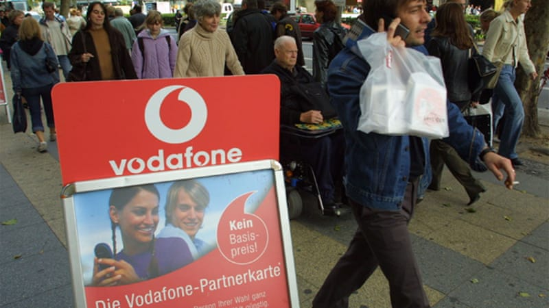 "With a presence in more than 70 nations, Vodafone is deferring ""to local authorities"" in many countries well-known to be systemic abusers of human rights [GALLO/GETTY]"