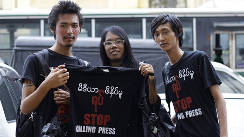 "Reporters wearing black T-shirts emblazoned with the slogan ""Stop Killing the Press""  marched across Yangon [Reuters]"