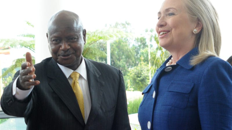 Clinton visited Yoweri Museveni, left, as part of her seven-nation African tour that will last 11 days  [EPA]