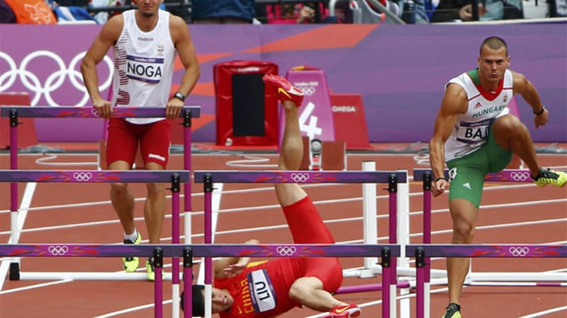 Chinese hurdler Liu Xiang made history by winning his country's first men's track and field gold medal in the Athens Games [Reuters]