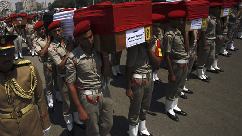 A military funeral was held in Cairo for the 16 border guards killed in an attack on Sunday [Reuters]