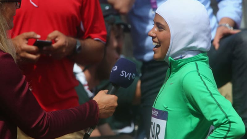 Attar beams after becoming first Saudi Arabian woman to compete in athletics [GALLO/GETTY]