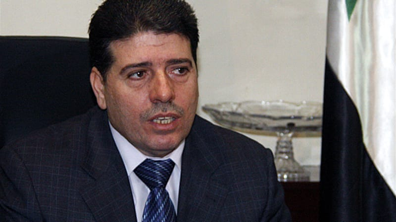 Former health minister Wael al-Halqi became prime minister after Riyad Hijab defected and fled Syria [EPA]