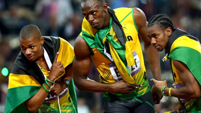 Take a bow: Bolt led a Jamaican clean sweep with training partner and rival Yohan Blake taking silver and Warren Weir claiming bronze [EPA]