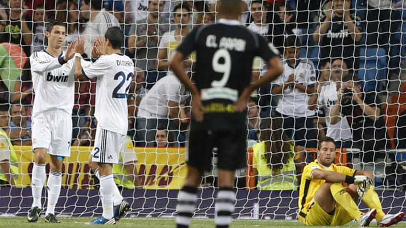 Ronaldo scored his 149th and 150th goal for the Spanish champions who claimed their first win of the season over Granada [EPA]