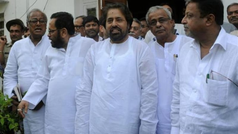 Six cabinet ministers from the regional Trinamool Congress party handed in their resignations in New Delhi [AFP]