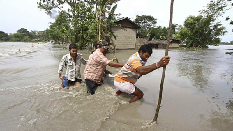 Monsoon rain have triggered heavy floods, disrupting road transport and damaging houses in the northeast [Reuters]