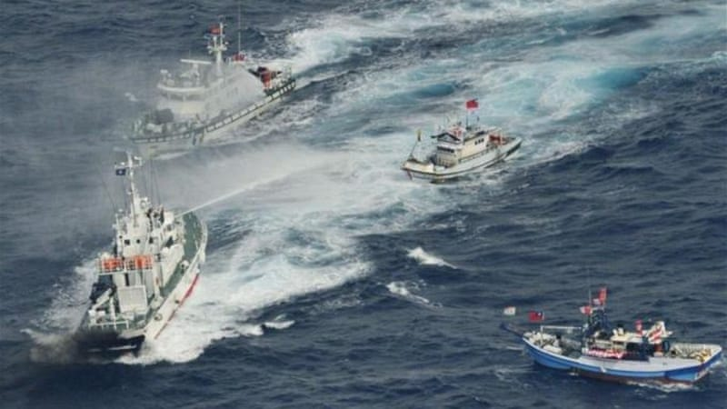 Japanese Coast Guard ships sprayed water at Taiwanese fishing boats near the disputed islands on Tuesday [Reuters]