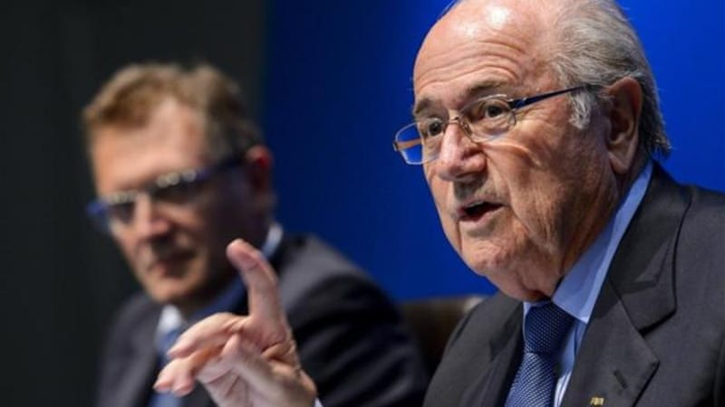 FIFA President Sepp Blatter (R) says football reflects all aspects of society, including violence [AFP]