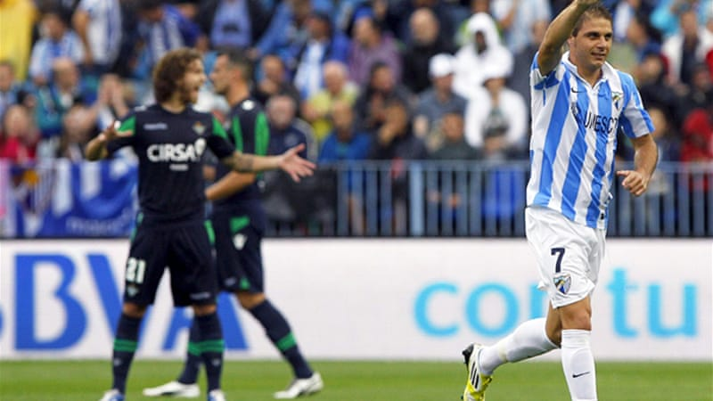 Malaga dominated the match following the sending-off of Betis goalkeeper Casto Espinosa, with Joaquin Sanchez, above, netting the resulting penalty in the 12th minute [EPA]