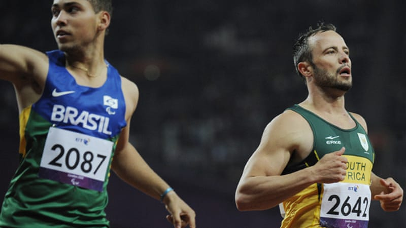 Pistorius, right, lost his T44 200m title after rival Oliveira, left, came from way back to pip him at the line [EPA]