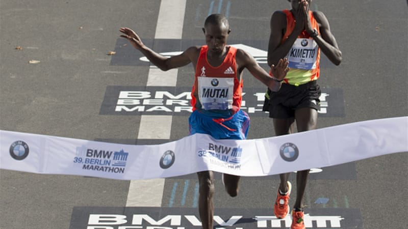 The 30-year-old Mutai was followed across the line one second back by compatriot Kimetto, who was making his marathon debut [Reuters]