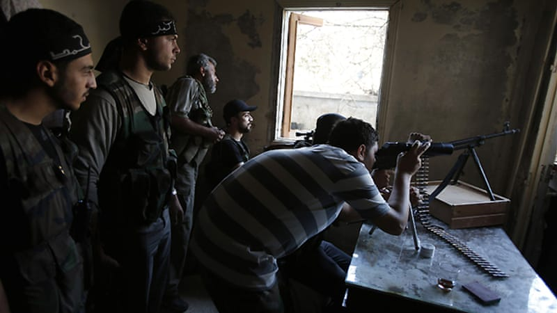 A Free Syrian Army sniper takes up position in Seif El Dawla neighbourhood of Aleppo [File: Reuters]
