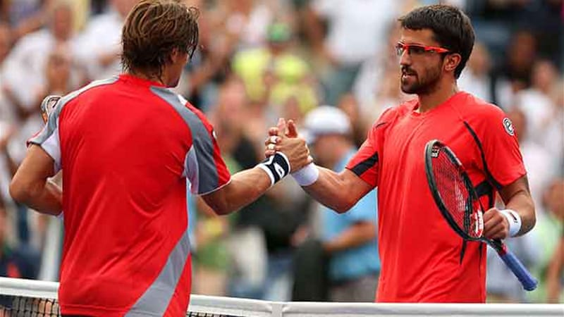 Ferrer shakes hands with Tipsarevic after their quarterfinal match in Flushing Meadows on Thursday [AFP]