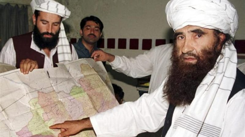 Nasiruddin Haqqani , left, and his father Jalaluddin, right [Reuters]