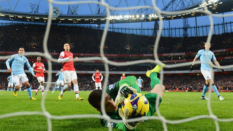 Despite Dzeko's penalty being saved by Arsenal keeper Wojciech Szczesny, Man City took advantage of their man advantage [GALLO/GETTY]