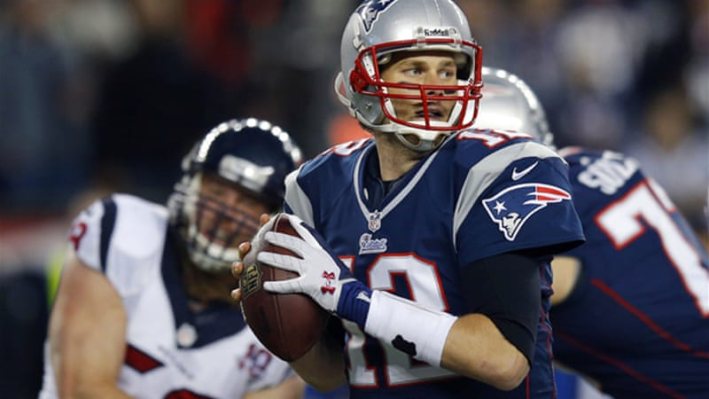 Brady completed 25-of-40 passes for 344 yards and three touchdowns to help the New England Patriots set up a rematch of last year's AFC title game with the Baltimore Ravens [Reuters]