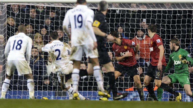 Robin van Persie's first-half goal appeared to have secured the points for the English leaders until Clint Dempsey, above, slid home an equaliser, much to the dismay of the travelling United fans [Reuters]