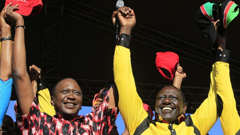Kenyatta, left, and his running mate Ruto, right, both face charges related to 2007 post-election violence [Reuters]