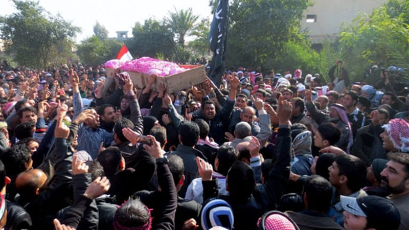 "Mourners hoisted caskets and waved Iraqi flags while shouting ""Allahu Akbar""! or God is great [AFP]"