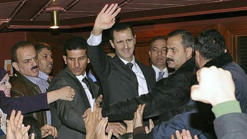 A defiant Assad on Sunday presented what he described as a new initiative to end the civil war in Syria [Reuters]