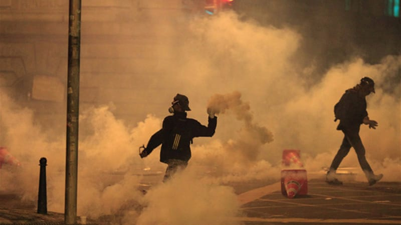 Police used tear gas and percussion grenades to disperse the activists [Reuters]