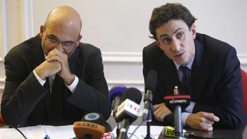 Lawyers Slim ben Achour (R) and Felix de Belloy (L) pledged to appeal the ruling [AP]