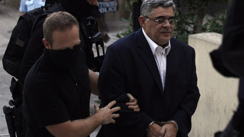 If convicted, Golden Dawn leader Nikos Michaloliakos faces at least 10 years in prison [AP]