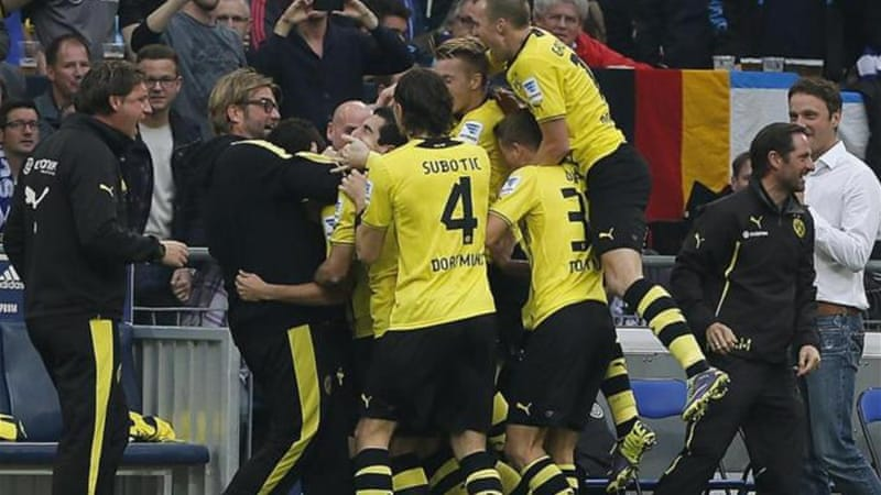 Under Klopp (2nd L), Dortmund had their best financial season in 2012-2013 after reaching Champions League final [AP]