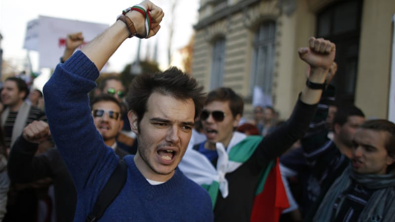 "Protesters shout anti-government slogans in a march under the banner of ""March of Justice"" [Reuters]"