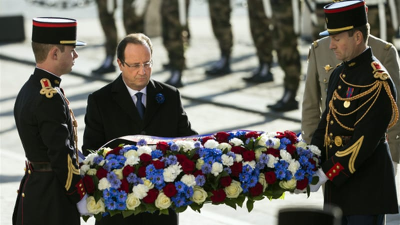 Protesters booed French President, Francois Hollande (C), at an Armistice Day memorial ceremony [EPA]