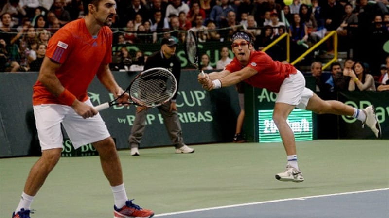 Serbia's Nenad Zimonjic, left, and Ilija Bozoljac struggled to get a grip on the game from the start of the match [AFP]