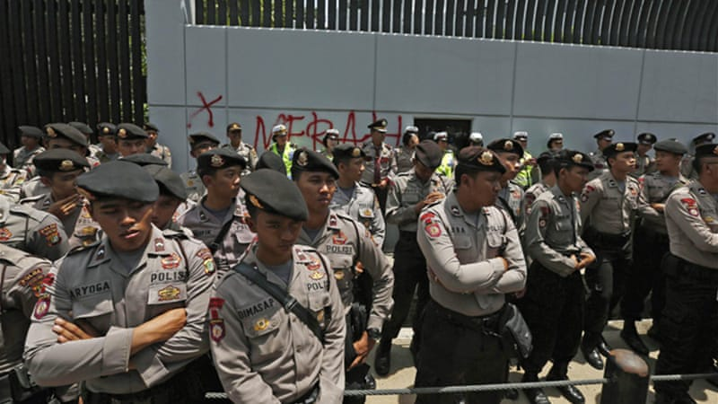 Indonesian policemen stand guard in front of the Australian embassy in Jakarta. REUTERS