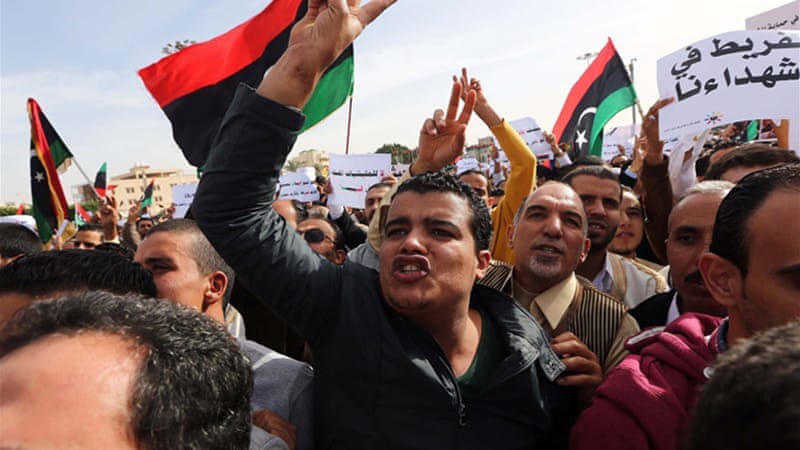 Libyans have demonstrate in the streets to demand the withdrawal of all armed groups from the capital [AFP]