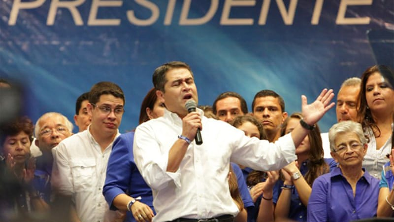Juan Hernandez had shown a definite lead in polls over rival Xiomara Castro [AFP]