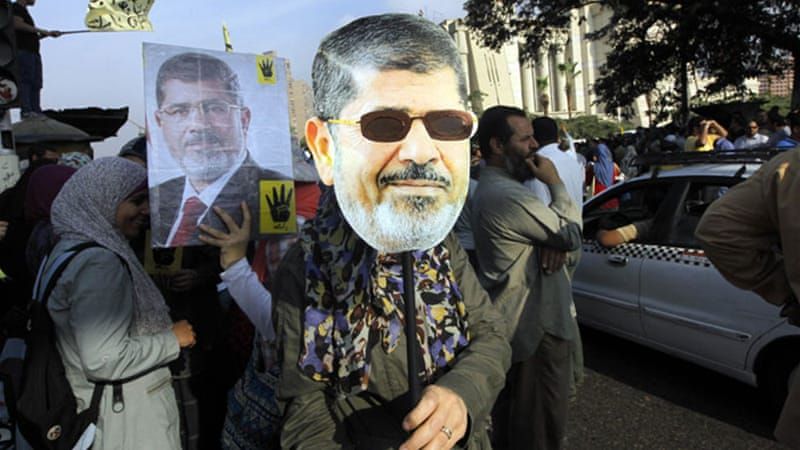 Morsi supporters protested outside the court where the deposed president faced the initial charges [EPA]