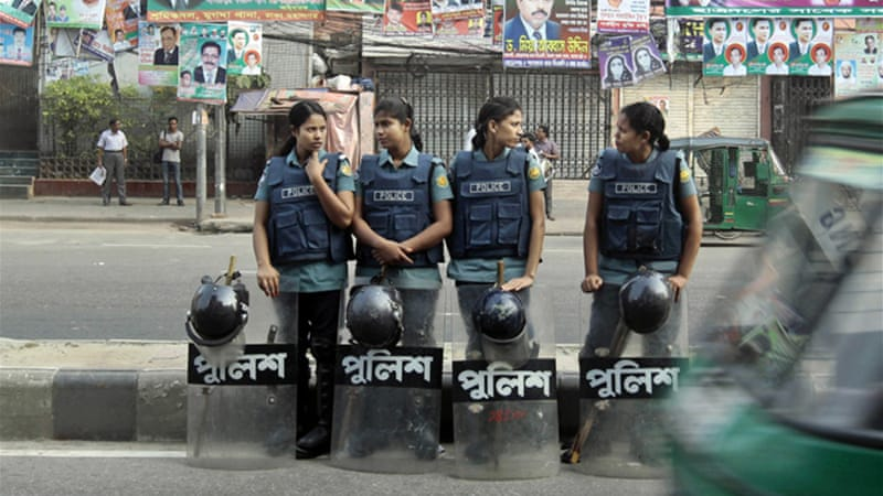 Police and paramilitary guards were drafted to patrol in Dhaka [AP]