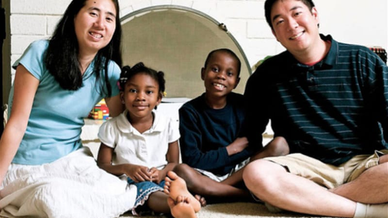 Matthew and Grace Huang moved to Qatar in 2012 with adopted children [AP]