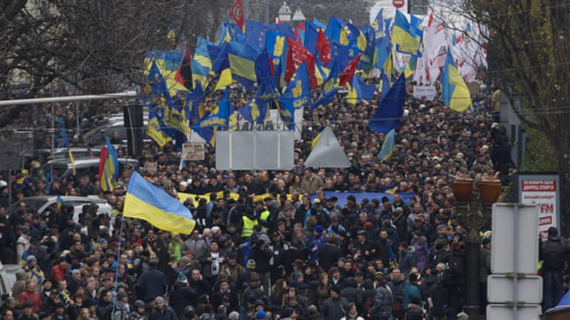 Protesters want President Yanukovych and Prime Minister Azarov to step down  [AP]