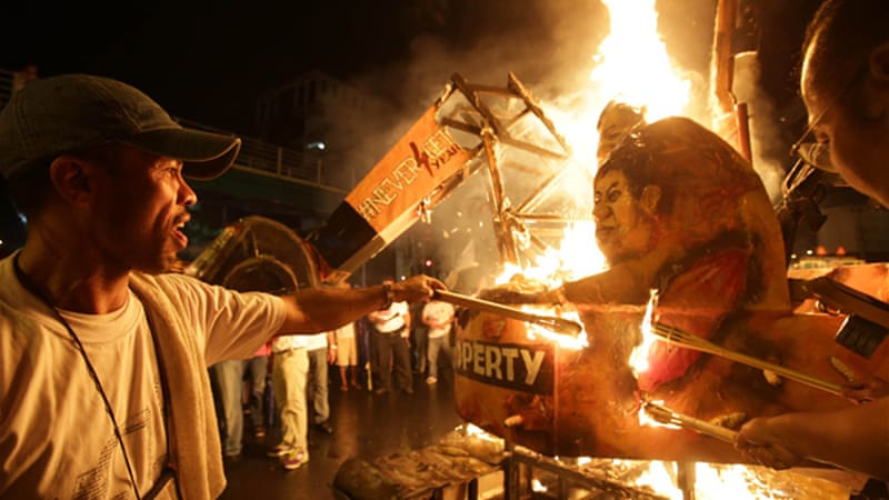 Journalists burned an effigy of a backhoe in November to protest violence against journalists in the country [AP]