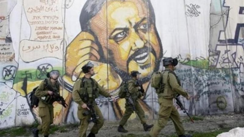 Serving five life sentences behind Israeli jail, Barghouti may yet succeed Mahmoud Abbas as president  [AP]