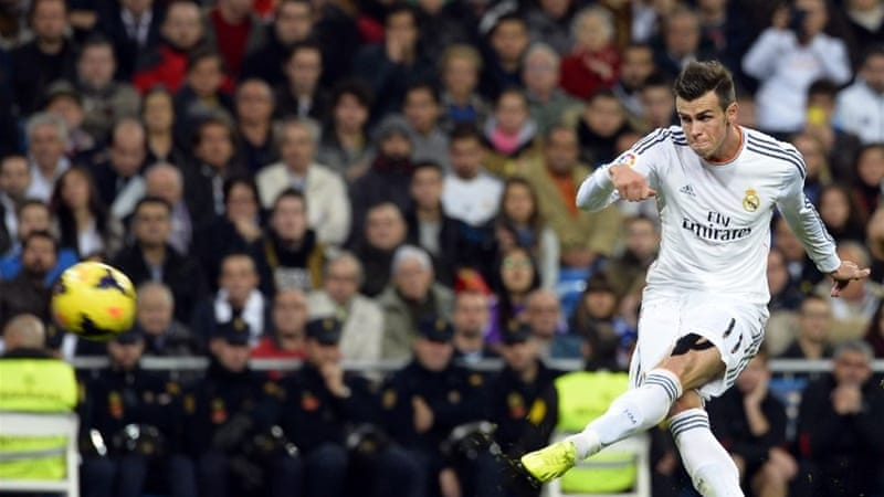 The world's most expensive footballer Gareth Bale scores his second goal for Real Madrid against Sevilla FC  [AFP]