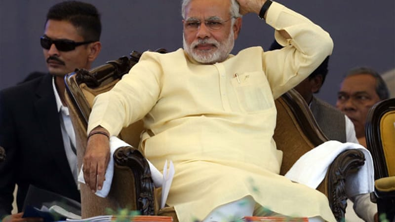 "The BJP, stating it would legally challenge the inquiry, termed the move as a ""witch hunt"" against Modi [Reuters]"