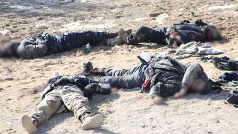 Syrian state television showed footage of dozens of bodies lying in a mountainous area [SANA]