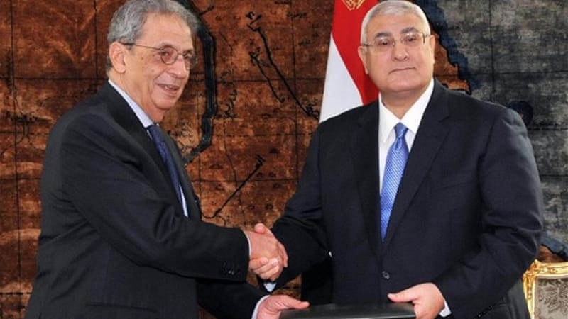Amr Mussa has given the draft constitution to Adly Mansour, who must decide on  a referendum date  [AFP]