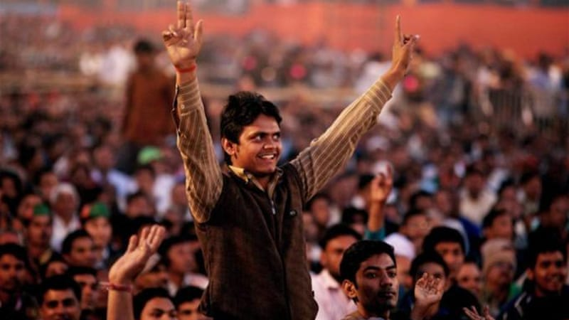 Though seen as divisive, Narendra Modi has been drawing big crowds in his campaign trail [EPA]